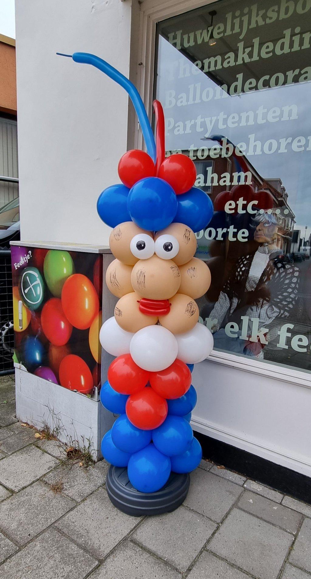 Zwarte piet van ballonnen foto